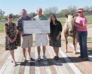 Randy Geurin Presents a $25,000 check to TROT