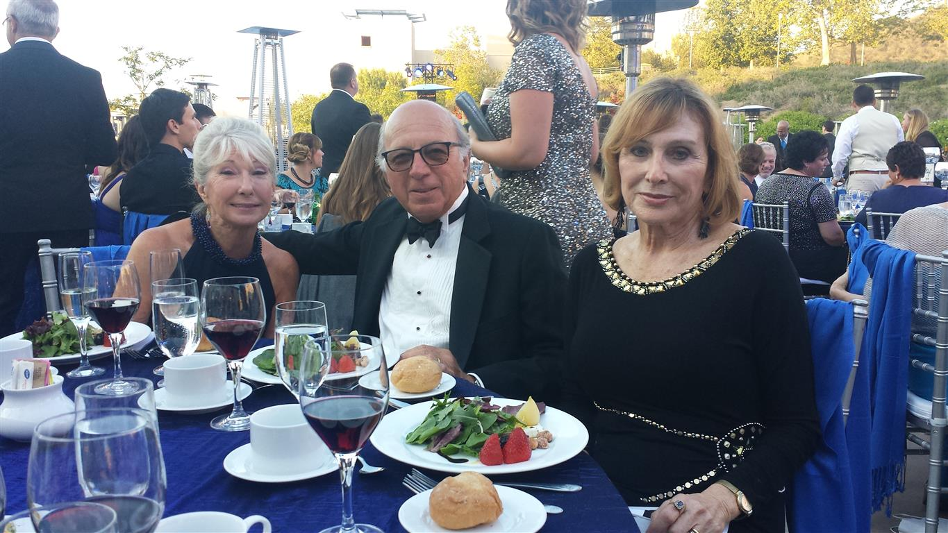 Board member, Liz Vasek-Kane representing the Donegan Burns Foundation at California State University San Marcos 25 Anniversary Gala.  Seated at her left are guests, Frank and Catherine.