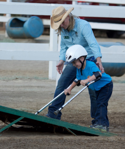 Westen Nack makes his way up a ramp with instructor Jodi Pinhero so he can get up on a horse for a demonstration ride.